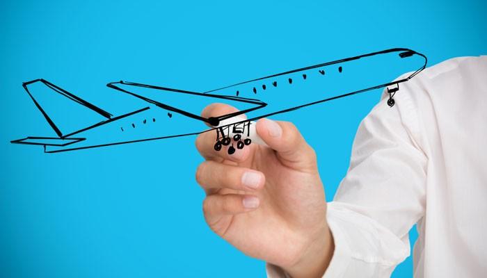 Hand zeigt auf stilisiertes Flugzeug