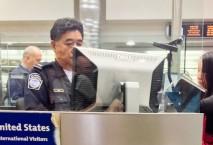 Frau steht am USA Border Control Schalter, Foto: iStock