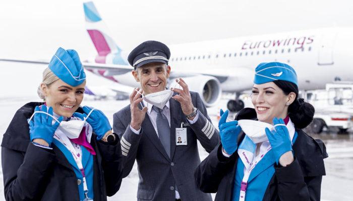 Airline-Crew mit Masken. Foto Eurowings
